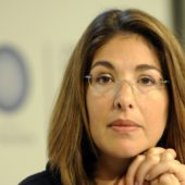 Canadian author Naomi Klein annouces the winner of the Angry Mermaid award, given to the company which has done the most to sabotage effective action to tackle climate change, at the Bella center of Copenhagen on December 15, 2009 on the the 9th day of the COP15 UN Climate Change Conference. Monsanto received 37% of the votes ahead of Royal Dutch Shell 18% and the American Petroleum Institute 14%. AFP PHOTO / OLIVIER MORIN (Photo credit should read OLIVIER MORIN/AFP/Getty Images)